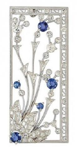Art Deco Sapphire, Diamond and Platinum Brooch, circa 1925.  The rectangular openwork frame, centring a floral spray set with round sapphires and diamonds, mounted in platinum. #ArtDeco #brooch