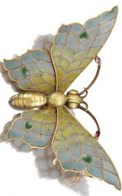 ENAMEL AND DIAMOND BROOCH, LATE 19TH CENTURY. Designed as a butterfly, the wings and antennae decorated with polychrome plique-a-jour enamel, detachable brooch pin, French assay marks.