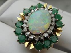 oh man... 14K gold Emerald and Opal w/ Diamonds cocktail Ring. $2,400.00, via Etsy.