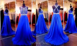 Royal Blue Prom Dress-High Beaded Neck-Open Back-Only at Rsvp Prom and Pageant, Atlanta, GA... This gorgeous gown features a sheer mesh bodice and jewel neckline. It has a low back embellished with clear stones and sequins. The full A-line skirt is made f