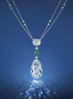 The Eye of Golconda:  The Eye of Golconda – Set with a pear-shaped diamond weighing 40.05 carats, to the old mine-cut diamond surmount weighing 6.76 carats, spaced by an octagonal-shaped emerald weighing 0.87 carat and diamond beads, suspended from a doub