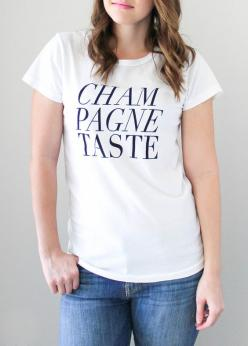 Champagne Taste Tee - This feminine cut, stylish tee is perfect for the girl with expensive taste and an eye for designer duds!
