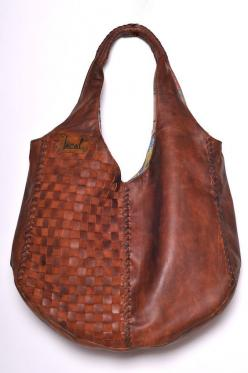 This gorgeous handmade Bella tote in vintage brown leather will definitely become your favorite everyday bag. Handcrafted from high quality leather with lots of love and care it features stunning weaving on the body and leather bound handles.