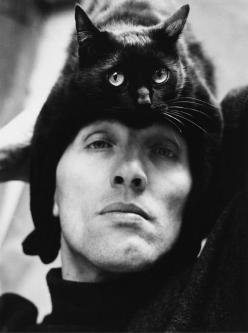 "(German photographer Herbert Tobias and his cat, Tobias.) * * TOBIAS: "" HE PUTS MEEZ HERES. ME THINKS DE SAUERKRAUT HE ATES FER LUNCH WENTS TO HIZ BRAIN."": Cat People, Peter O'Toole, Herberttobias, Black Cats, 1962, Photography, Animal"
