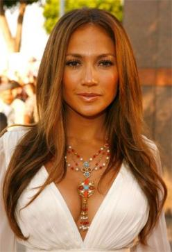 Get JLo's sleek look by applying Davines' Momo Fluid Moisturizing Anti-Frizz Protective Fluid and then following up with a flat iron!