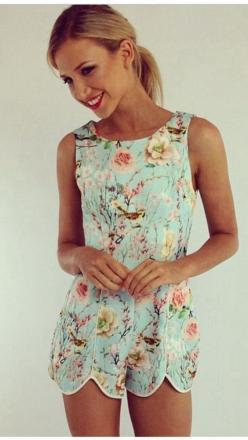 I am overly obsessed with this floral romper it's lovely I really want one