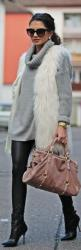 could do with out THIS kind of fur vest but I do love a good furry vest...whole outfit is cute