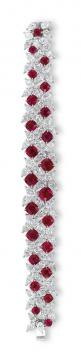 A RARE RUBY AND DIAMOND BRACELET, BY FAIDEE  The highly articulated pear-shaped diamond bracelet interspersed with twenty-three cushion-shaped rubies weighing approximately 23.21 carats total, the reverse accented by brilliant-cut diamonds, mounted in pla