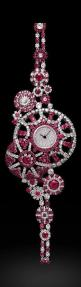 https://www.bkgjewelry.com/sapphire-ring/519-18k-white-gold-diamond-blue-sapphire-solitaire-ring.html Ruby and Diamond watch by BOUCHERON I believe.