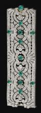 EMERALD AND DIAMOND BRACELET, CIRCA 1925.  Designed as a wide open work band of palmette and scroll design, collet-set at intervals with cabochon emeralds, millegrain-set with circular- and single-cut diamonds, mounted in platinum,  French assay marks, ca